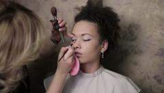 Makeup of african american woman in a salon. Time lapse - stock footage