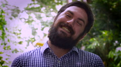 Portrait of a bearded man smiling and tilting head Stock Footage