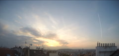 Cloudy sunset over roofs in Prague with Prague Castle in back,4 times time-lapse Stock Footage