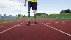 4K Disabled athlete with prosthetic leg running at the running track - stock footage