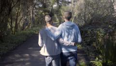 Affectionate Gay Couple Take A Walk In Golden Gate Park, San Francisco Stock Footage