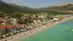 Beach, bay and hills from the air Stock Footage