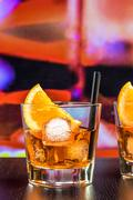 Glasses of spritz aperitif aperol cocktail with orange slices and ice cubes o Stock Photos