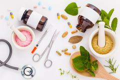 Herbal medicine VS Chemical medicine the alternative healthy care on white ba Stock Photos