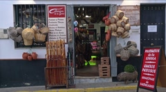 Panning up shot of an Iberian ham and meat shop in Andalusia, Spain. Stock Footage
