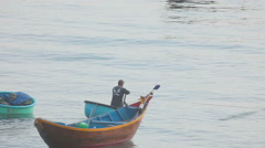 Fisherman on a round boat out to sea Stock Footage