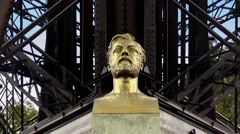 Stock Video Footage of Monument (bust) Alexander Gustave Eiffel at the Eiffel Tower in Paris. 4K.