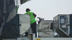 Unloading luggage from the plane Stock Footage