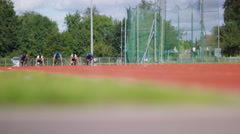 Stock Video Footage of 4K Multiracial group of athletes competing in race at running track