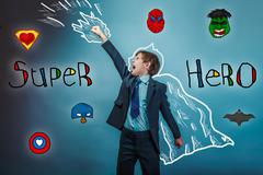 Superhero boy raised his hands superpower  businessman flying ph Stock Photos