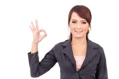 Portrait of a young attractive confident business woman, success, yes, ok - stock photo