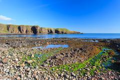 Beautiful landscape of hill and rock at Dunnottar castle area, Aberdeen Scotl Stock Photos