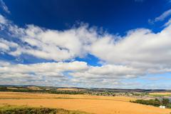 Wheat field and blue sky with clouds at shore line close to North sea, Aberde Stock Photos