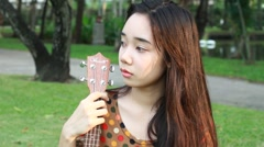 Portrait of thai student teen beautiful absent-minded in park. Stock Footage