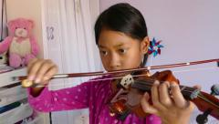 Nine Year Old Girl Practising Her Violin Stock Footage