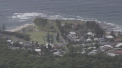 Elevated shot of headland with surf breaking Australia . - stock footage