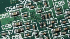 Green Printed Circuit Board PCB Macro Close-up Pan Stock Footage