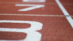 4K Low angle view of numbered lanes on a running track. No people - stock footage