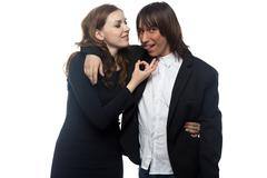 Woman and happy man in black jacket Stock Photos