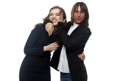 Angry woman and man in black jacket Stock Photos
