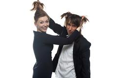 Woman and man in black jacket holding hairs Stock Photos