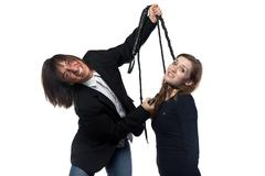 Mad man in black jacket holding woman with whip Stock Photos