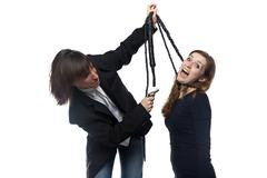 Man in jacket holding screaming woman with whip - stock photo