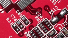Red Printed Circuit Board PCB Macro Close-up Pan Stock Footage