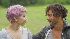 4K Portrait of happy couple outdoors embracing & smiling to camera - stock footage