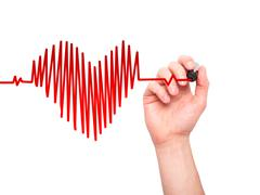 Closeup of hand drawing heart beat in heart shape with stethoscope Stock Photos