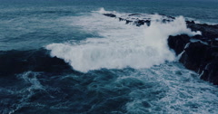 Aerial Shot of Giant Surf Crashing Against Sea Cliffs - stock footage
