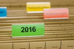 Hanging file folder labeled with 2016 Stock Photos
