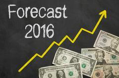 Text on blackboard with money - Forecast 2016 Stock Photos
