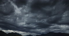 Darkness dramatic sky over the mountains, floating clouds, time lapse 4k video Stock Footage
