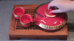 Tea pouring in chines cup Stock Footage