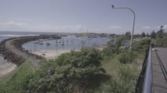 Marina with moored yachts and breakwater - stock footage