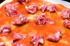 Homemade Pizza  preparation with Sauasage Stock Photos