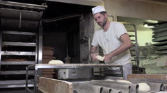 Rolling and shaping dough baguette bread Stock Footage
