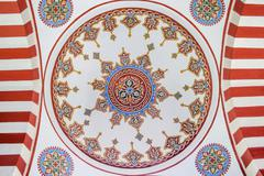 Restored Paintings on Interior Wall of a Mosque Dome - stock photo