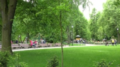 Children play on playground with swings, carousels and sand. 4K Stock Footage