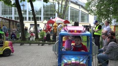 parents look after kids children in carousel train cars. 4K - stock footage