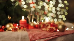 two glasses of champagne with christmas present and christmas balls - stock footage