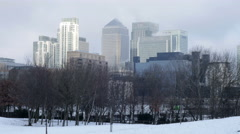 Time Lapse of London's Canary Wharf Financial District in Winter Snow Stock Footage