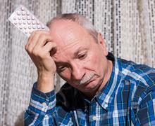 Elderly man wants to take a pill Stock Photos