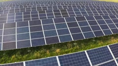 Aerial shot of solar farm moving forwards, wide shot. Stock Footage