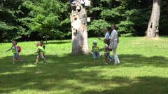 Two young nanny woman spent time with small children in park. 4K - stock footage