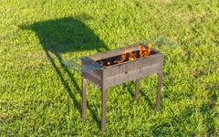 Firing Barbecue after Blazing of Firestarter Liquid - stock photo