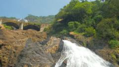 large waterfall and swimming people - stock footage