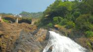 Stock Video Footage of large waterfall and swimming people