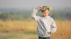 Caucasian girl in a field of flowers. Portrait of a girl close up. - stock footage
